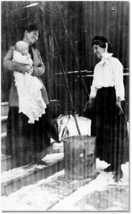 Nurse Janet Hamilton (right) on a house visit (Toronto Archives, Series 474, Subseries 3, File 2, Item 53